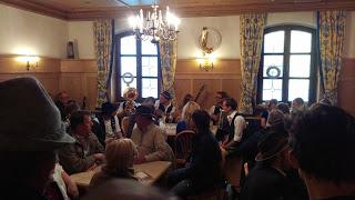 Musicians play in a crowded pub in Regen, Germany