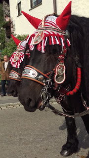 The Manes of the Horses are decorated with colorful twine and metal ornamentation.
